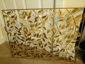 Gold tone metal wall art