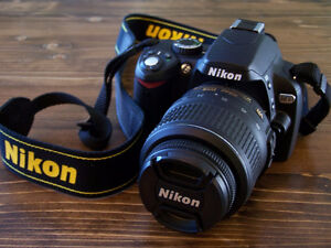 Nikon D-60 with lens and bag and 2 straps