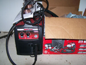 Lincoln 140 mig wire feed welder, and three rolls.