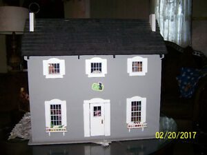 wooden doll house with dolls and play items