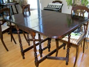 GATELEG DINING TABLE WITH FOUR UPHOLSTERED CHAIRS