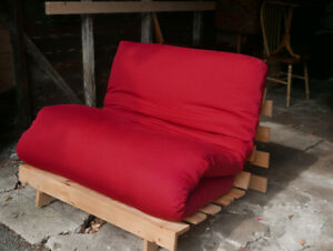 Pine futon with red cotton cover