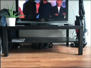 Black wooden IKEA coffee table TV stand