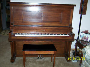 Antique Beckwith upright player piano.