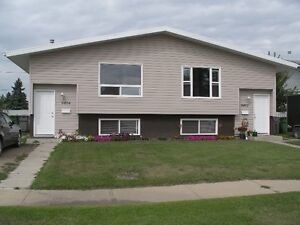 Modern Alberta side Duplex with large fenced yard!