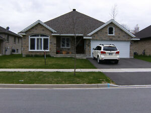 All Stone Bungalow with double garage.