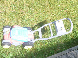 Fisher Price toy lawn mover