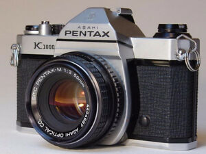 Pentax K1000 with a SMC Pentax-M 50mm lens and a Vivitar Flash