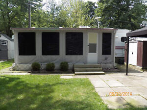 RV awning and soft-sided screen room