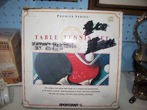 Table Tennis Set:. 4 Racquets, 2 Balls, Net, Instructions