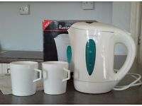 Russell Hobbs travel kettle with mugs.