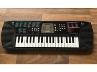 Casio SA-65 Electronic Songbank Keyboard with LCD.