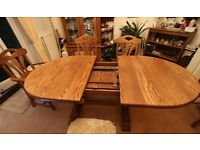 100% Belgian Oak dining table & chairs set. 3 regular chairs and 2 carver chairs.