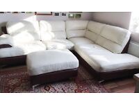 Cream leather corner sofa with matching footstool.