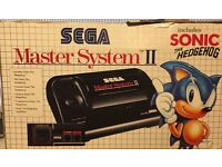 Sega Master System 2 + Pad Manuals/inserts and game