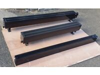 Three 'Bisque' low profile convector heaters. 2 used 1 unused.