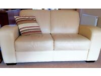 Cream leather 3 seater and 2 seater couches