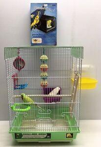 Cage + accessoires pour oiseaux à vendre
