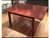 Dark wood extendable dining table Ikea seats 4-8