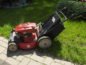Self Propelled  lawn mowers in good working condition with bag