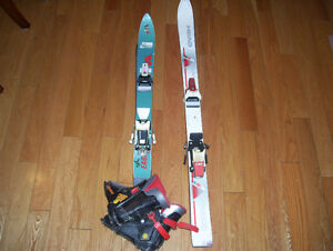 Two Pairs of Childrens Skis and 1 Pair of Ski Boots