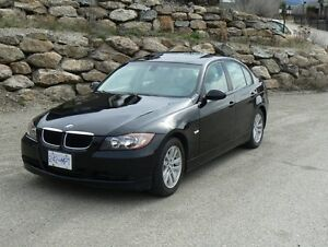 2007 BMW 323i with 2 sets of OEM rims and good tires!