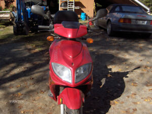 Scooter comme neuf à vendre
