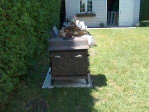 poel a bois en fonte avec ventilateur et acc