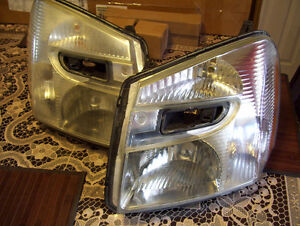 2 Lumieres Avant / Headlamp Original Equinox 2005 - 2009