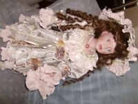 PORCELAINE DOLL WITH LONG CURLY HAIR