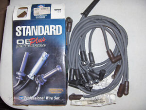 Spark plug wires and coil on plug boots all new in boxes