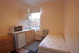Shepherds Bush. Lovely bedsit in a clean, quiet house. Most bills included