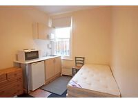 Bright, double bedsit with own kitchenette. Bills included in price.