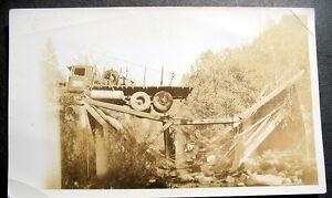 1930s-CONSTRUCTION-TRUCK-STUCK-ON-BROKEN-WOODEN-BRIDGE