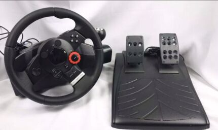LOGITECH STEERING WHEEL AND PEDDLE SET  Gympie Gympie Area Preview