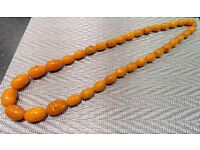 Large butterscotch amber coloured beaded necklace, 90 cms long, approx weight 190g