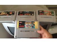 Super Nintendo console 4 games 2 pads all wires