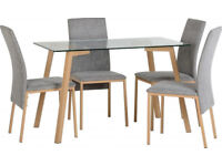 Morton Dining Set in Clear Glass/Oak Effect Veneer - Grey Fabric Chairs Brand New Flat Packed