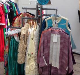 Four arm shelf heavy duty clothing rail display