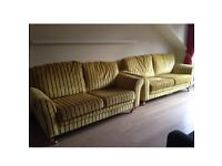 Velvet lemon sofas with navy stripe