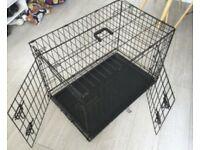 Dog crate. Medium size. Hardly used. Two door.