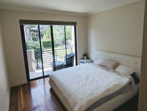 Large furnished room with private balcony