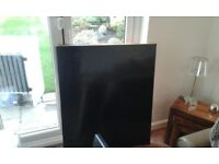 3 difference sized black worktops and breakfast worktop