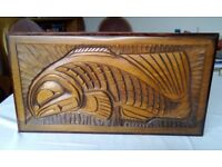 Carved wooden wall plaque