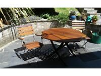 Wooden Hexagonal Table and two folding wooden chairs