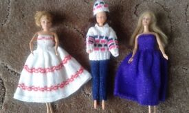 3 Barbie sized dressed dolls