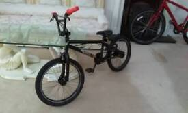 X rated dark black bmx new lava grips and silver dustcaps