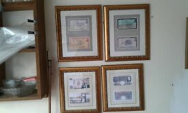 Full gold picture frames with prints of old money
