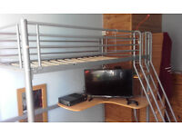 Single metal Loft bed and desk.