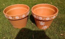 2 large patterned clay pots
